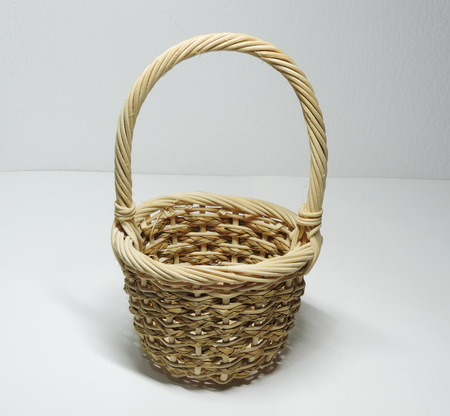 A cute handmade basket made of wicker. Stock Photo