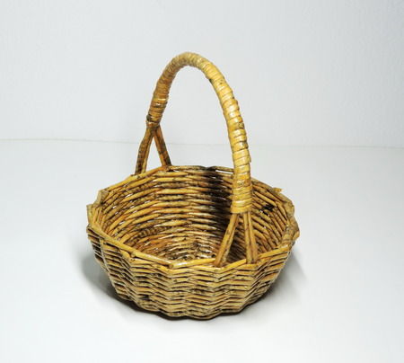 A cute handmade basket made of newspapers paper. Stock Photo
