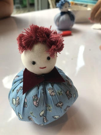 Cute handmade fabric tumbler doll in Thailand.