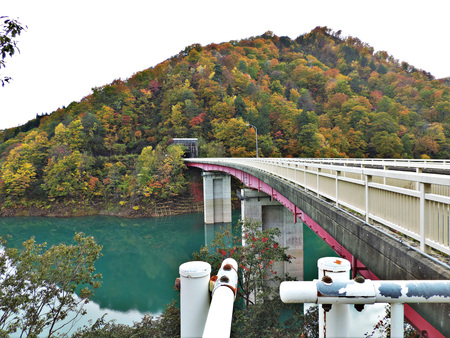 Scenery of leaves color change and turquoise water in Akita prefecture of Japan.