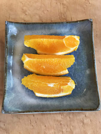Dish of slice bright oranges.