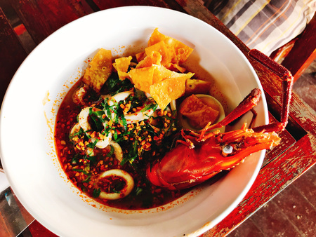 River prawn and squid in Thai spicy noodle soup served with crispy wonton skin.