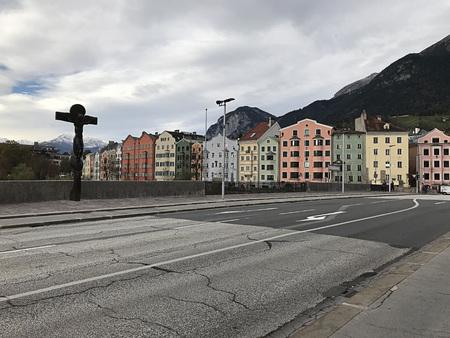 Innsbruck, Austria - October 31, 2018:  Sculpture and pastel buildings surrounding River Inn in Innsbruck, Austria. Editorial