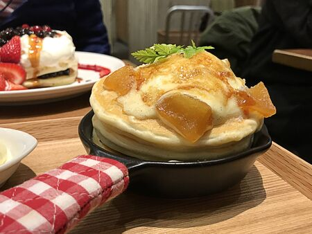 Grilled apples and creme brulee pancakes served with honey and vanilla ice cream in Japan.