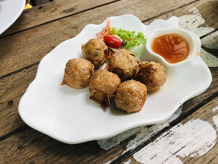 Jock shell crab or Hoi Jor or Deep fried crab  meat roll served with plum sauce.