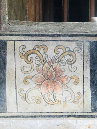 Bangkok, Thailand - July 27, 2019: Beautiful paintings on the wall of the building of LHONG 1919 in Bangkok, Thailand. Lhong 1919 located on the bank of the Chao Phraya river, the mid-nineteenth century Sino-Siamese port now welcomes all to savour it's ri