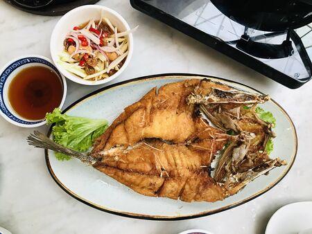 Thai style Deep Fried Sea Bass served with Green Mango Salad.
