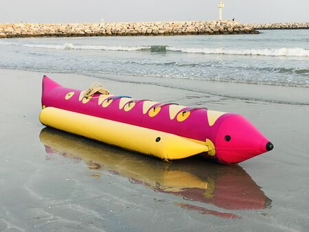 Outstanding and colorful banana boat on the beach in Thailand.