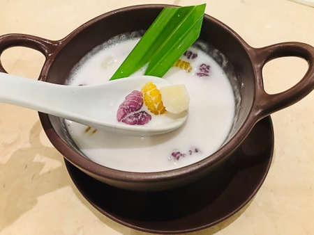 Thai traditional dessert...Krong krang or Sweet rice gnocchi in coconut milk. Фото со стока