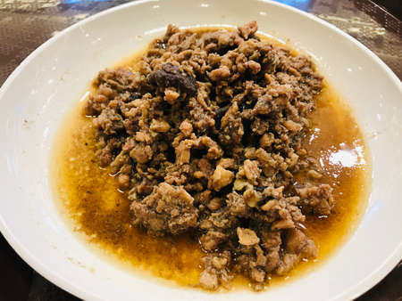 Stir fried minced pork with salted Chinese black olive in Thailand. Фото со стока