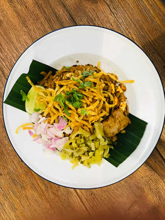 Northern style curry crispy noodle with chicken in Thailand. Фото со стока