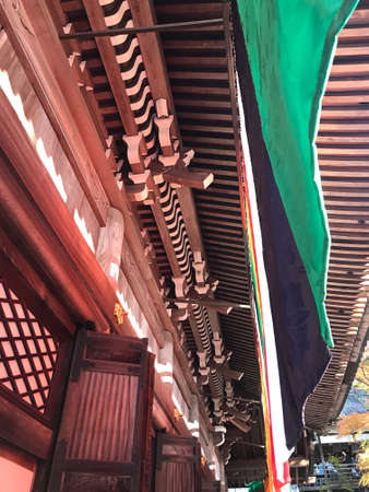 Kyoto, Japan - December 1, 2019: Wooden roof details of Eikando Zenrinji Temple. The temple has a long history and there are a variety of buildings and a pond garden that very famous for its autumn co 新闻类图片