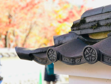 Kyoto, Japan - December 1, 2019: Roof tile art of Eikando Zenrinji Temple. The temple has a long history and there are a variety of buildings and a pond garden that very famous for its autumn colors.