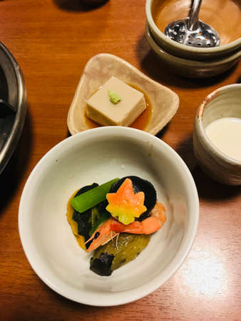 Simmered dish and steamed tofu with soy sauce. 免版税图像