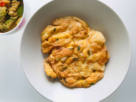 Stir fried large noodles with egg.