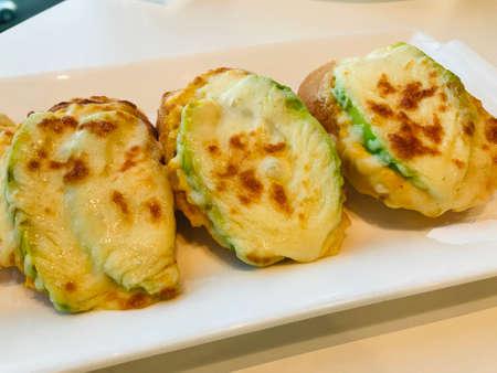 Garlic bread with tuna cheese avocado.