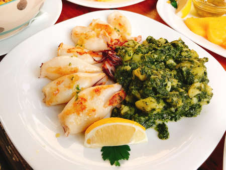 Grilled squids with chard and potatoes in Piran, Slovenia. Standard-Bild
