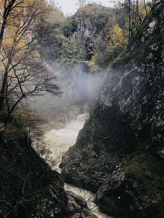 The enormous amout of water of Reka River flowing out of Skocjan Caves in Slovenia. Archivio Fotografico