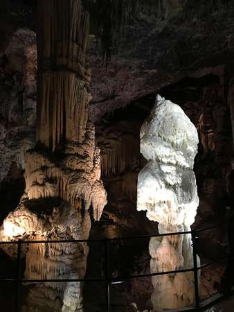 Stalactite and stalagmite of Postojna Cave in Slovenia.