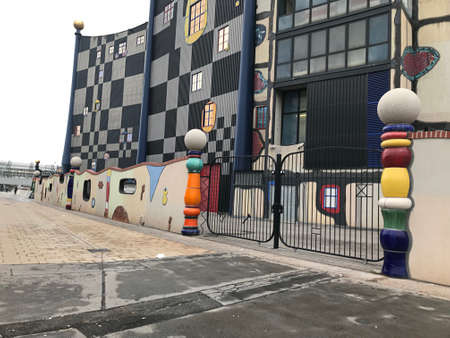 Vienna, Austria - November 11, 2018:  The bright vivid colors on curves and spirals of the Fernwarme Wien Spittelau district heating plant building that designed by Friedensreich Hundertwasser. 新闻类图片