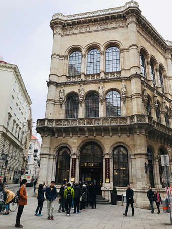 Vienna, Austria - November 11, 2018:  Many customers stand in line waiting to enter the Café Central. It is a traditional Viennese café that operated by Palais Events and located inside Palais Ferstel