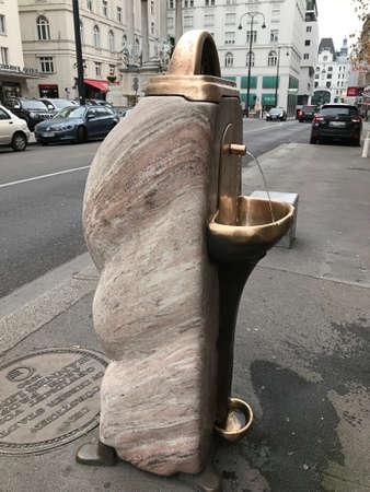 Vienna, Austria - November 11, 2018:  A public drinking water service point on the Hoher Markt in Vienna, Austria.
