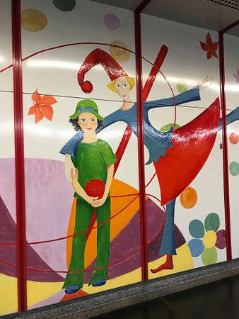 Vienna, Austria - November 11, 2018:  The enamel mural in Vienna Praterstern subway station was designed by Susanne Zemrosser, was hand-painted onto the panels by Ernesto Muller and Martina Schatz. 新闻类图片