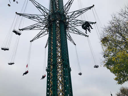 Vienna, Austria - November 11, 2018:  The Prater Tower at the Prater amusement park is a gigantic chain carousel which lets you fly around in circles, in about 117 m above the ground. At the same time