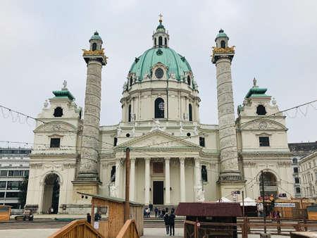Vienna, Austria - November 11, 2018:  St. Charles Church or Karlskirche is a Baroque church located on the south side of Karlsplatz in Vienna. The architect was Johann Bernhard Fischer von Erlach.