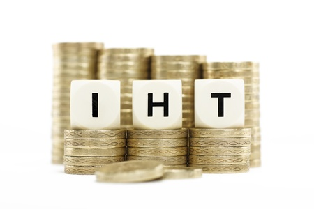 the inheritance: IIHT  Inheritance Tax  on gold coins with white background