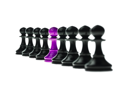 standing out from the crowd: Odd Chess Piece Standing Out From The Crowd Stock Photo