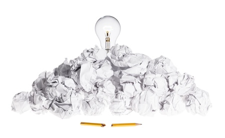 Problem Solving Concept Light Bulb On Pile of Crumpled Paper photo