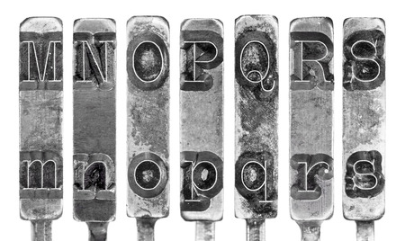 typebar: Old Typewriter Typebar Letters M to S Isolated on White