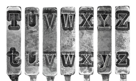 old typewriter: Old Typewriter Typebar Letters T to Z Isolated on White Stock Photo