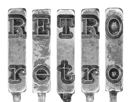 typebar: Word RETRO in Old Typewriter Typebar Letters Isolated on White Stock Photo