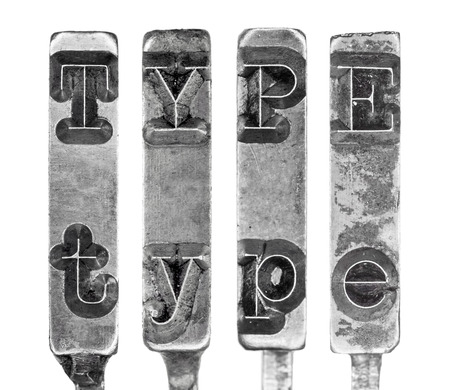 Word TYPE in Old Typewriter Typebar Letters Isolated on White photo