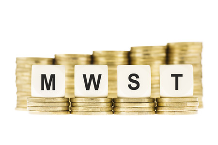 vat: MWST  German Value Added Tax  on Gold Coins Isolated on White