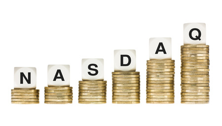 NASDAQ Stock Exchange Letters on Stacks of Gold Coins photo