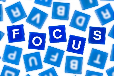 clarify: Word FOCUS in Clear Blue Letters Against Blurred