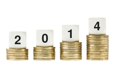 Year 2014 on Stacks of Gold Coins with White Background photo