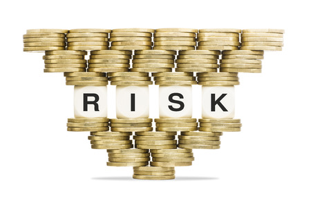 taking a risk: Risk Management Word RISK on Unstable Stack of Gold Coins