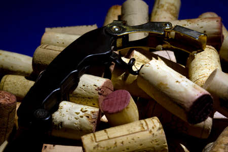 cork screw: A waiters cork screw with a bunch of corks Stock Photo