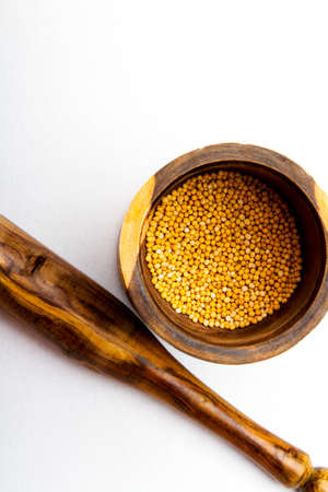 mortar and pestle: A colorful wood mortar  pestle with mustard seed