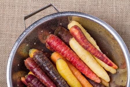 Multi-colored carrots in a colander