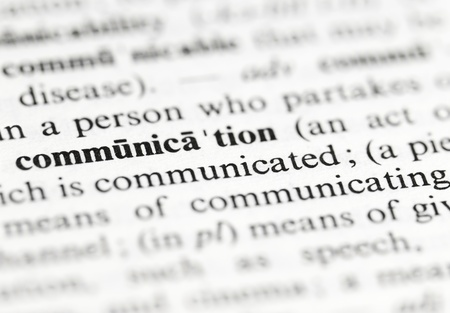 Close up of the word  communication  and its definition in the dictionary