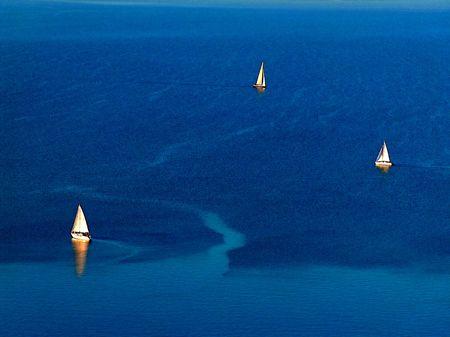 Three sailboats on the Balaton