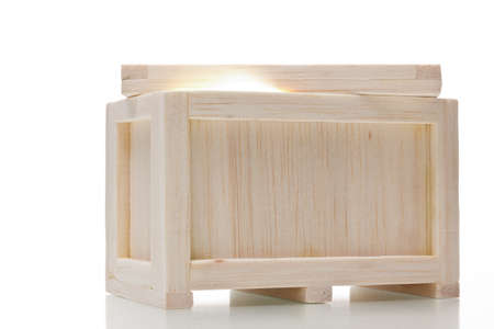 light in a wooden crate isolated on  white background