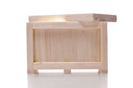 brighten: light in a wooden crate isolated on  white background