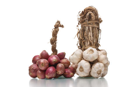 bunchs of  red onion and garlic  isolated on  white background Stock Photo
