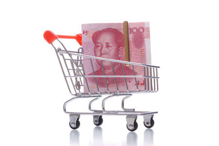 stack of yuan notes in shopping cart